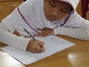Menuliskan laporan kegiatan